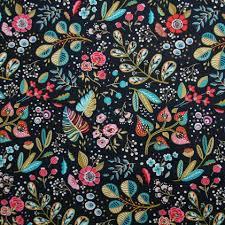 Tissu coton enduit noir fleuri rouge vert et doré